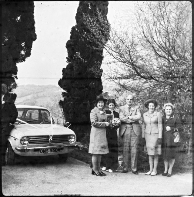 The lost film - Probably a Scottish wedding from 1973. - The car is an Austin Maxi, made in England between 1969 and 1981, and this particular one, it seems it was made in the first part of the interval, judging by the mirrors position. The plate was first registered in Edinburgh, somewhere between August 1973 and July 1974.